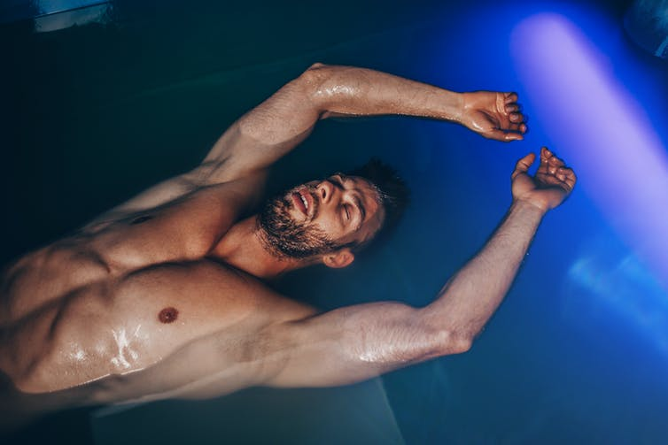 A man floating in a float tank