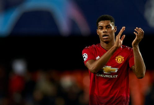 Marcus Rashford of Manchester United clapping his hands.