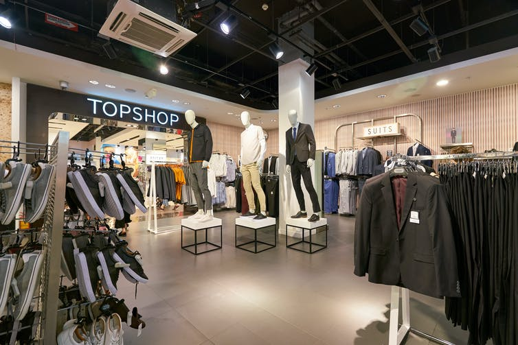 Shop floor of Topman with male mannequins and clothes.