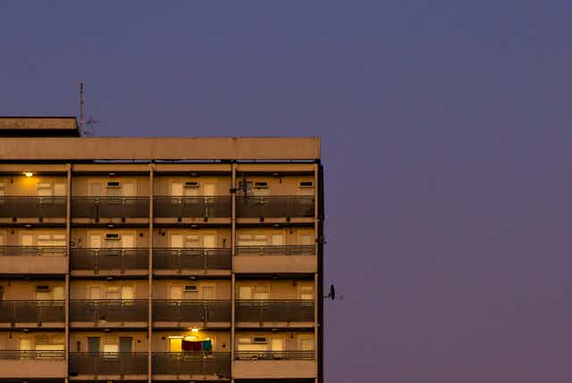 View of a tower block at dusk.