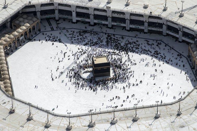 Muslim Hajj pilgrims at the Kaaba in Mecca, Saudi Arabia.