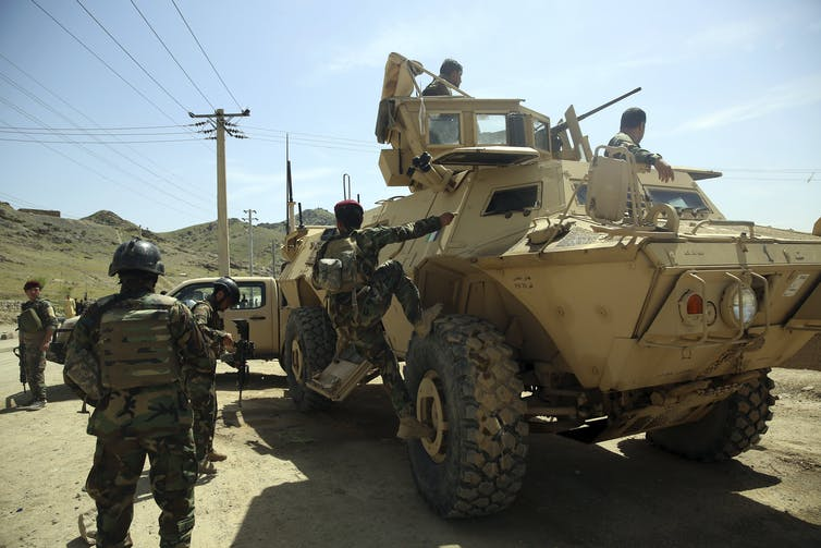Afghan troops continue to battle a Taliban-led insurgency