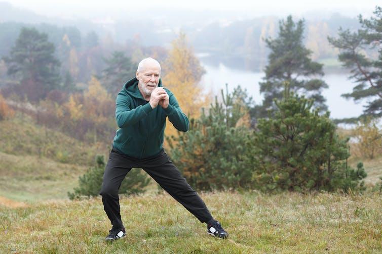 An older man exercising