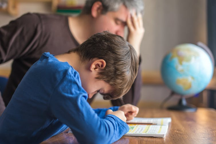 Father and son stressed over maths homework