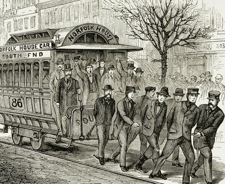 Engraving of men pulling a streetcar