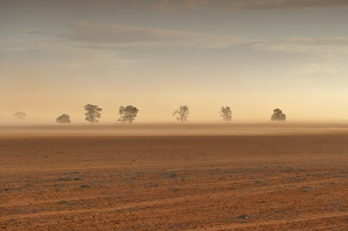Dust storm on a dry, brown farm