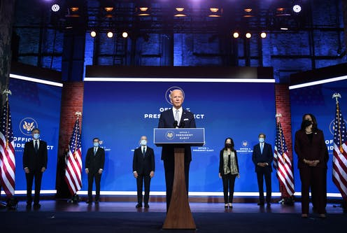 U.S. President-elect Joe Biden speaks on Nov. 24 with some of his cabinet picks standing behind him.