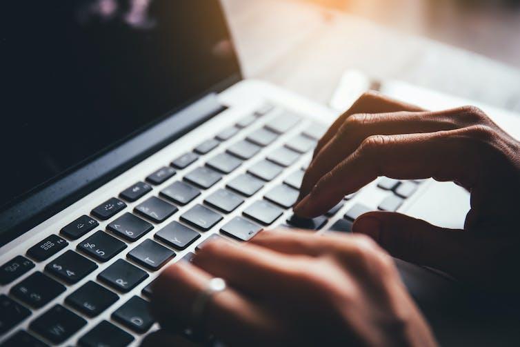 Hands at a keyboard