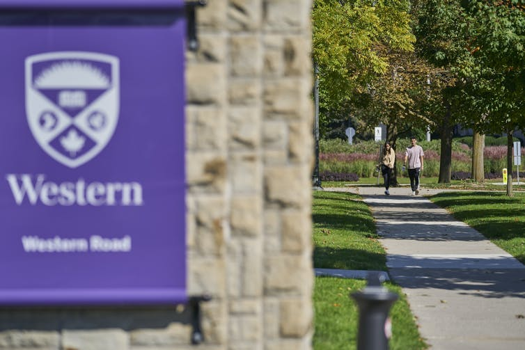 Students walk on a sidewalk.