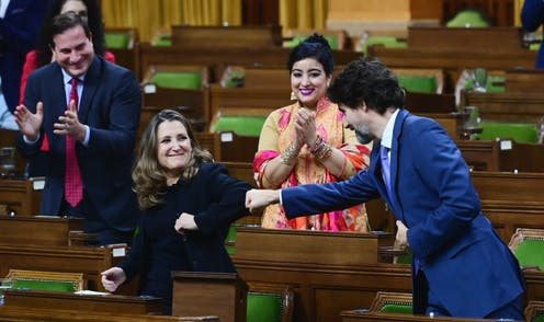 Justin Trudeau fist-bumps Chrystia Freeland's elbow.