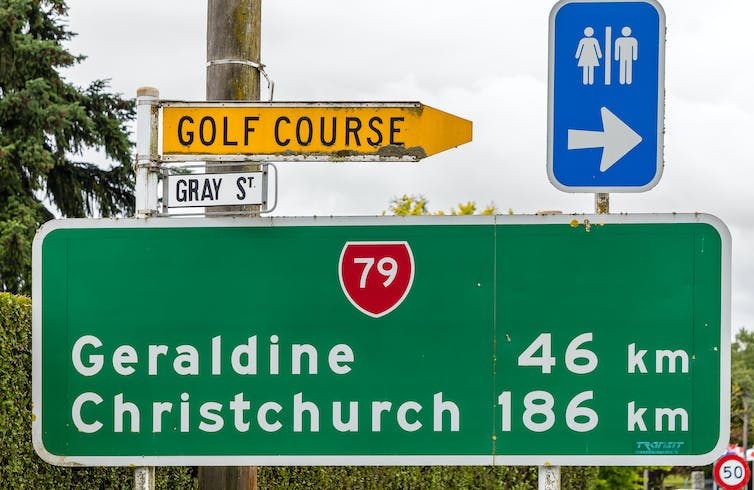 A road sign showing it's Geraldine in 46km and Christchurch 186km