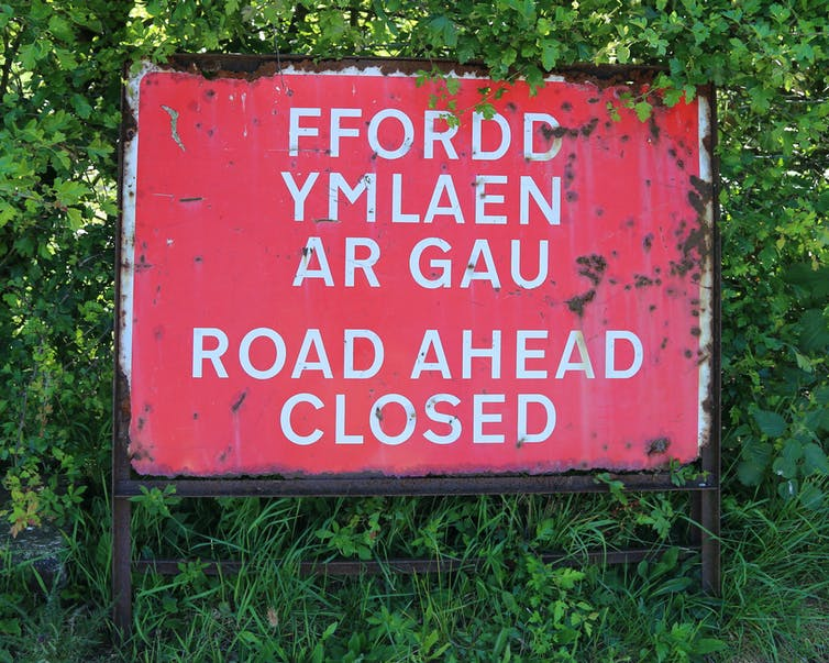 Bilingual Road Closed Ahead road sign in English and Welsh