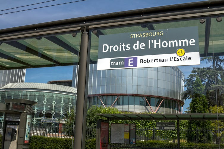 Tram station with sign saying 'Droits de l'Homme'
