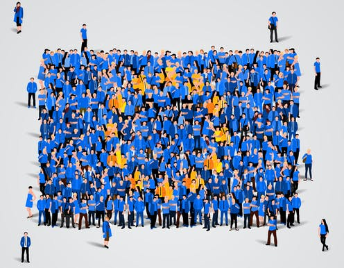 People gather wearing the blue and gold colours of the European flag.