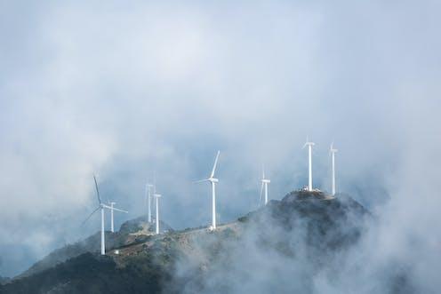 Wind turbines on a misty hillside