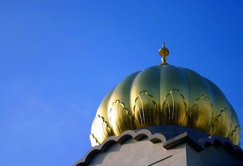 A golden dome of the Sri Guru Singh Sabha Gurdwara in Southhall, west London.