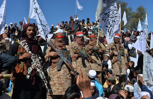 A crowd of armed fighters and civilians