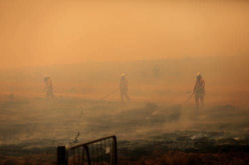 Firefighters putting out a bushfire