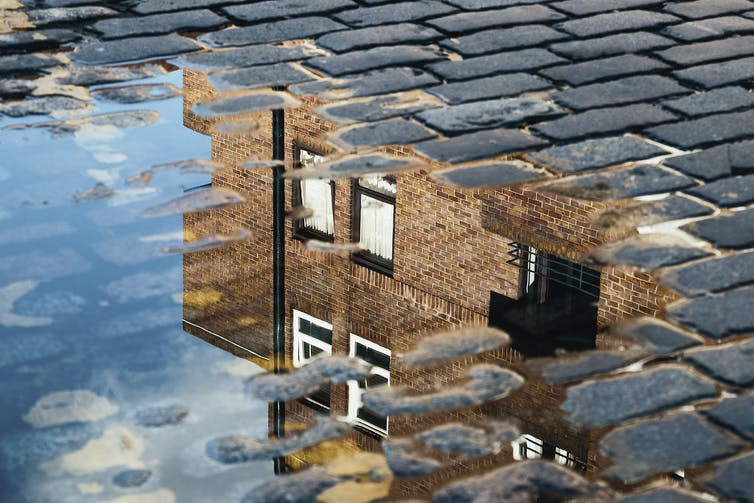 house in puddle reflection