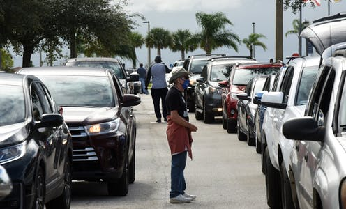 Cars lined up at a food distribution site in Florida.