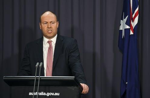 Australian Treasurer Josh Frydenberg speaks to the media during a press conference at Parliament House
