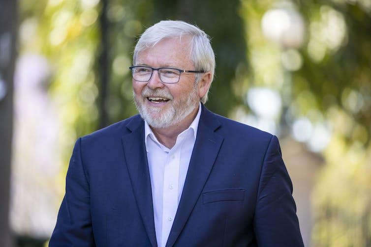 Kevin Rudd smiling, standing near the Brisbane City Botanic Gardens.