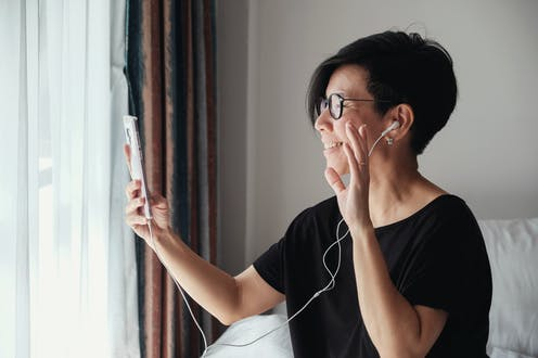 A woman uses her phone to video chat.