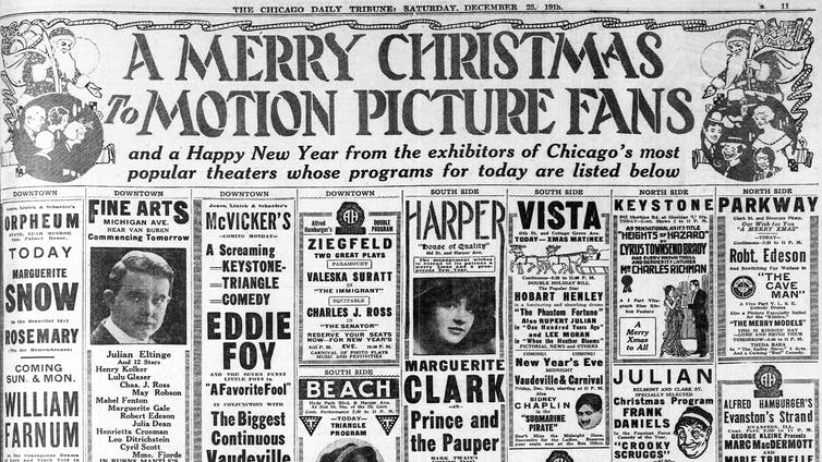 A newspaper showing Christmas ads for movies