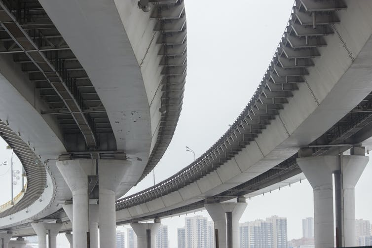 A concrete highway bridge viewed from below.