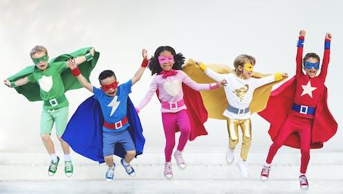 Children dressed as superheroes.