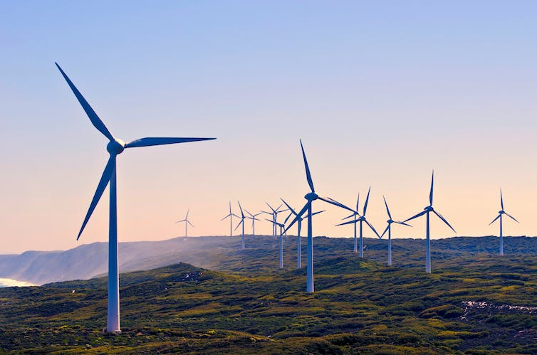 Wind turbines against a sunet