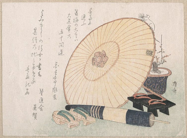 Antique Japanese artwork of umbrellas and traditional footwear.