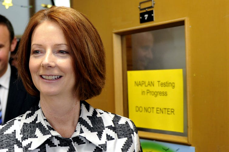 Julia Gillard in front of room where NAPLAN tests are in progress.