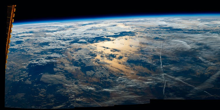 The view of sunrise over Earth as seen from the International Space Station