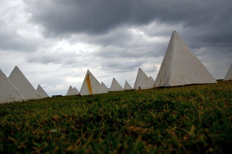 Small concrete pyramids designed to stop tanks.