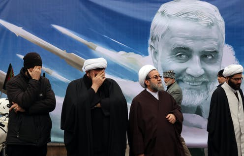 Four senior Iranian clerics in front of a poster depicting general Qasem Soleimani was was assassinated in Iraq in 2018.
