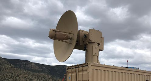 A dish antenna on a movable mount in a desert