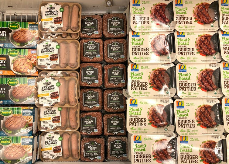 Packages of plant-based meat products in a freezer.