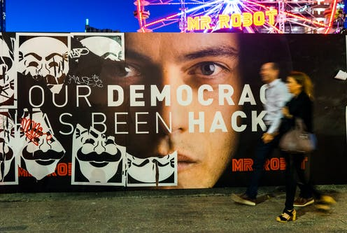 A poster of Mr Robot and two people walking in front of it at SXSW festival 2016