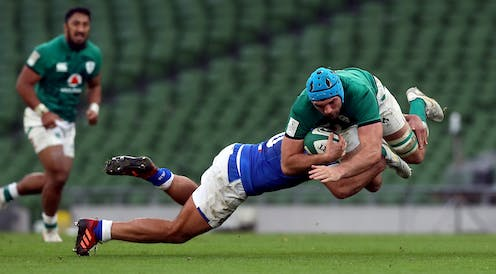 A rugby player tackled mid-air.