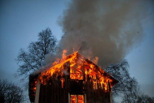 A house burns.