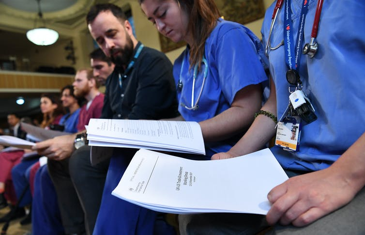 NHS staff with unredacted documents of secret talks between the US and UK governments, 27 November 2019