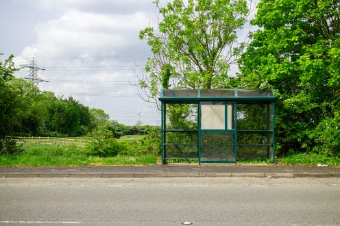 Empty bus stop on country lane