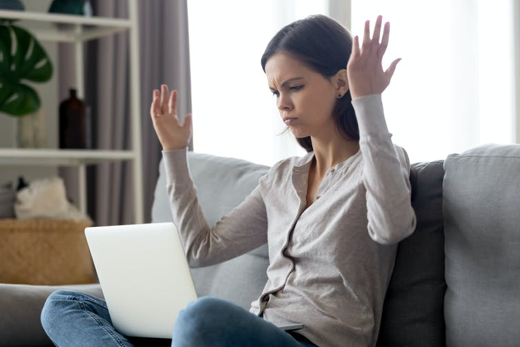 Woman on sofa angry with laptop