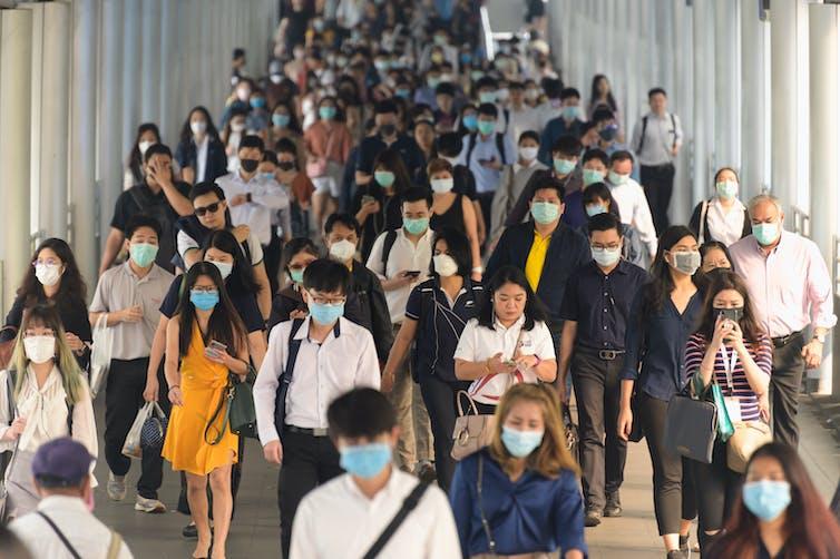 Lots of people in public wearing masks.