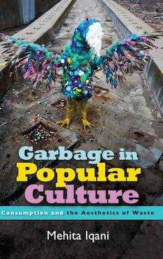 A book cover for 'Garbage in Popular Culture' that features a photograph of a sculpture of a bird, made from colourful plastic waste, taken in an urban setting.