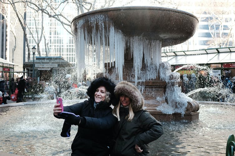 Two women outside during the winter.