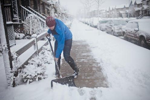 A man shoveling snow.
