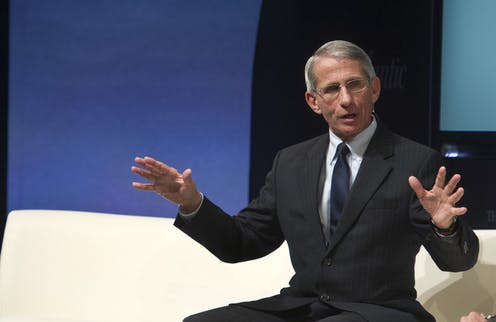 Fauci seats speaking onstage