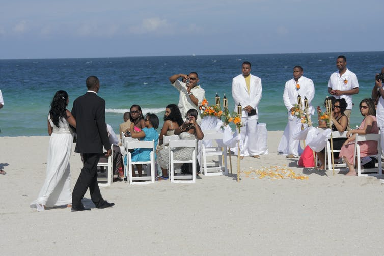 A Black couple gets married on the beach in Miami, Fla.
